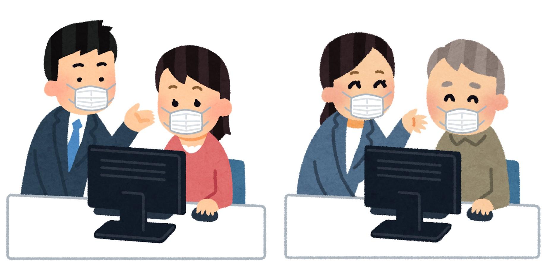 マスクをしてパソコンを教える人